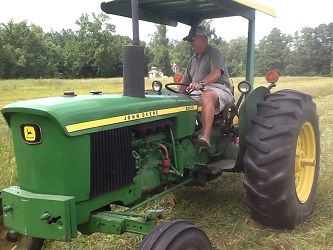 Elliott Hogge driving his tractor (from I am Ruritan Facebook page)